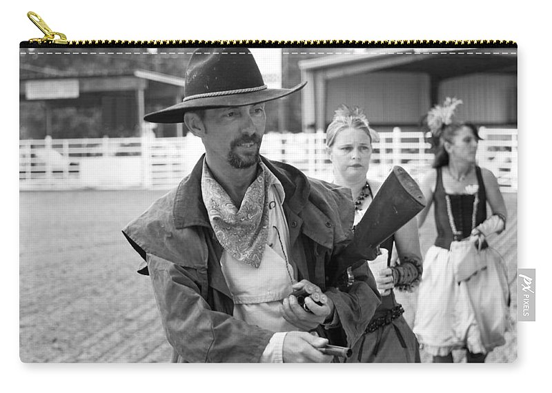 Rodeo Carry-all Pouch featuring the photograph Rodeo Gunslinger With Saloon Girls Bw by Sally Rockefeller