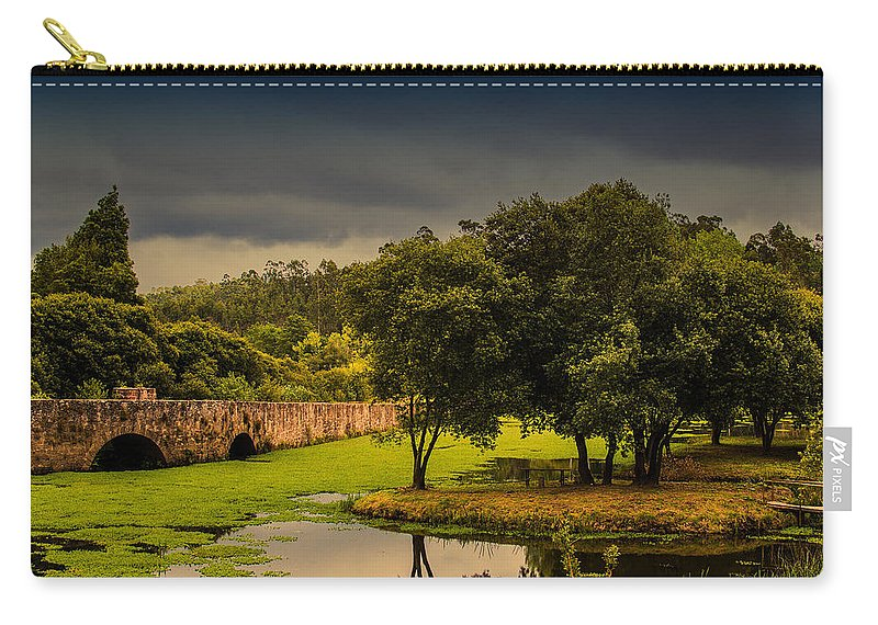 Roman Bridge By The Lake Carry-all Pouch featuring the photograph Roman Bridge By The Lake by Marco Oliveira