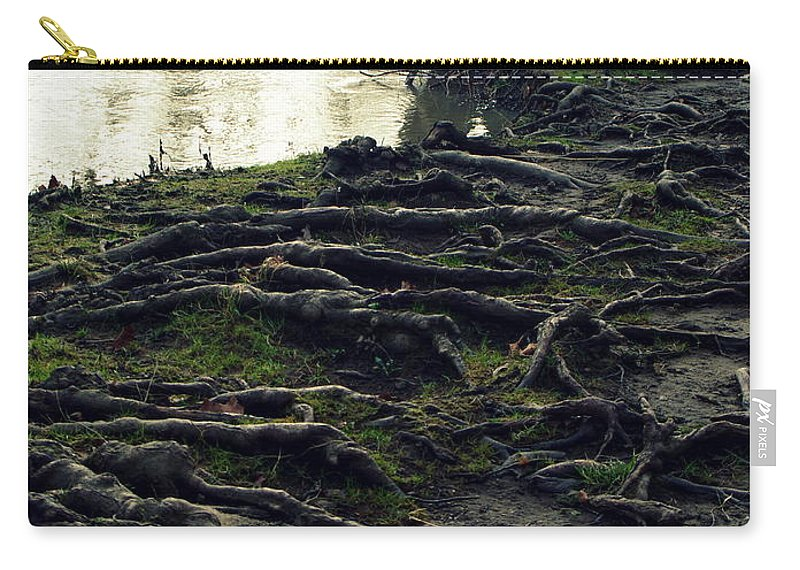 Tree Roots Growing Along River Carry-all Pouch featuring the photograph Roots On White River by Kitrina Arbuckle