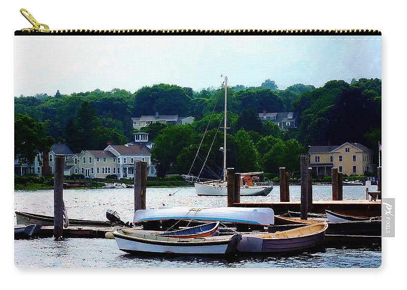 Boat Carry-all Pouch featuring the photograph Rowboats Piled At Dock by Susan Savad
