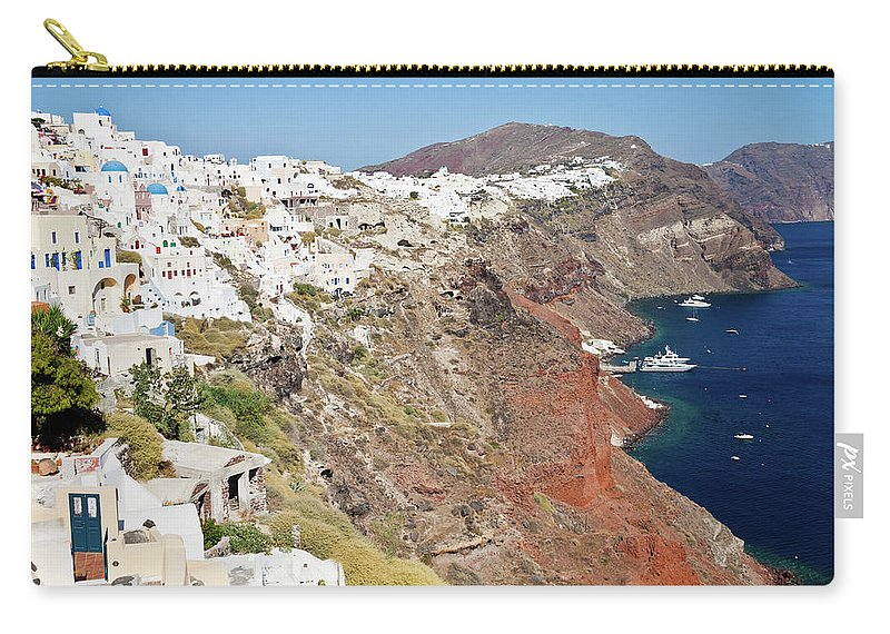 Tranquility Carry-all Pouch featuring the photograph Rows Of Houses Perch On Cliff In Oia by Melissa Tse