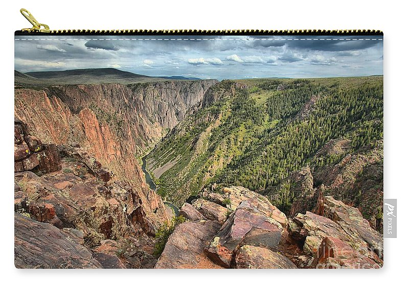 Black Canyon Carry-all Pouch featuring the photograph Rugged Edge Of The Canyon by Adam Jewell