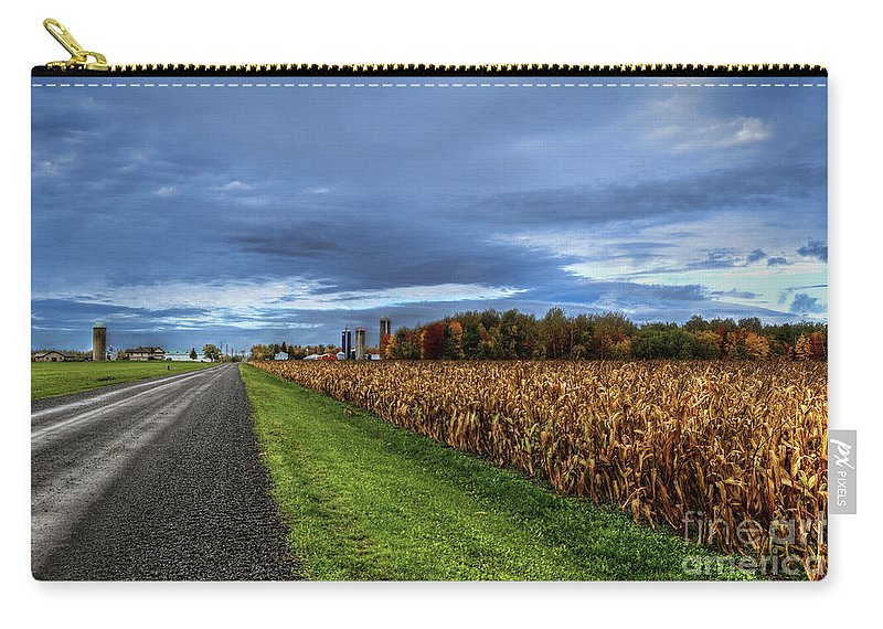 Rural Carry-all Pouch featuring the photograph Rural Drama.. by Nina Stavlund