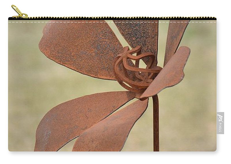 Rusted Iron Flower Carry-all Pouch featuring the photograph Rusted Iron Flower by Maria Urso