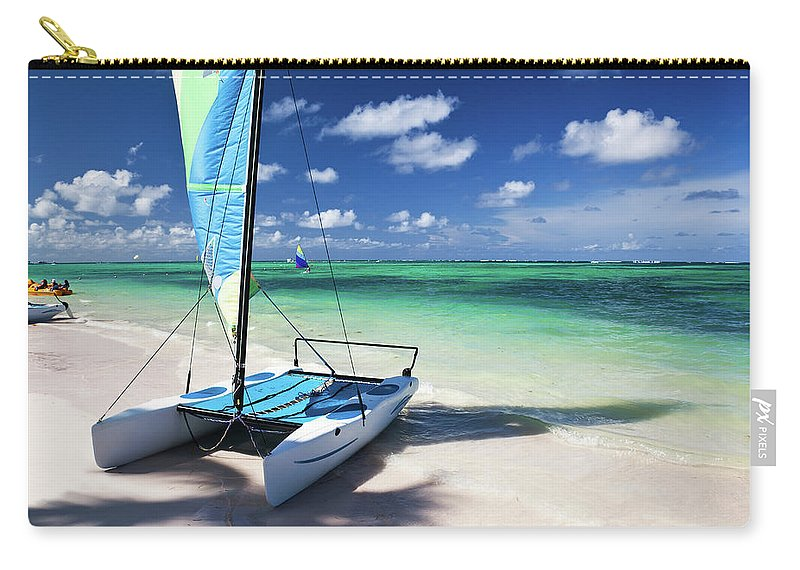 Wind Carry-all Pouch featuring the photograph Sailboat At Caribbean Sea by Danilovi