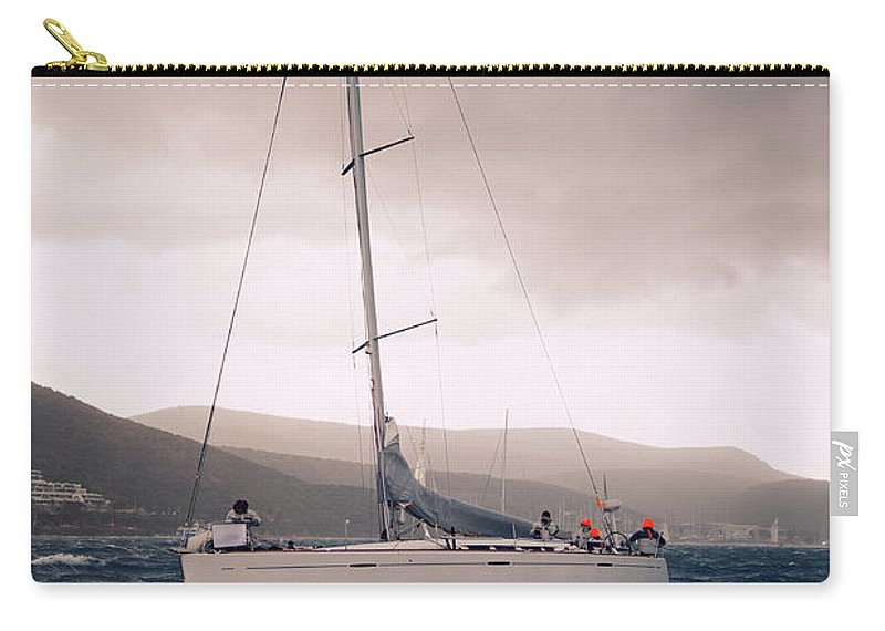 Recreational Pursuit Carry-all Pouch featuring the photograph Sailing And Stormy Weather by Travenian