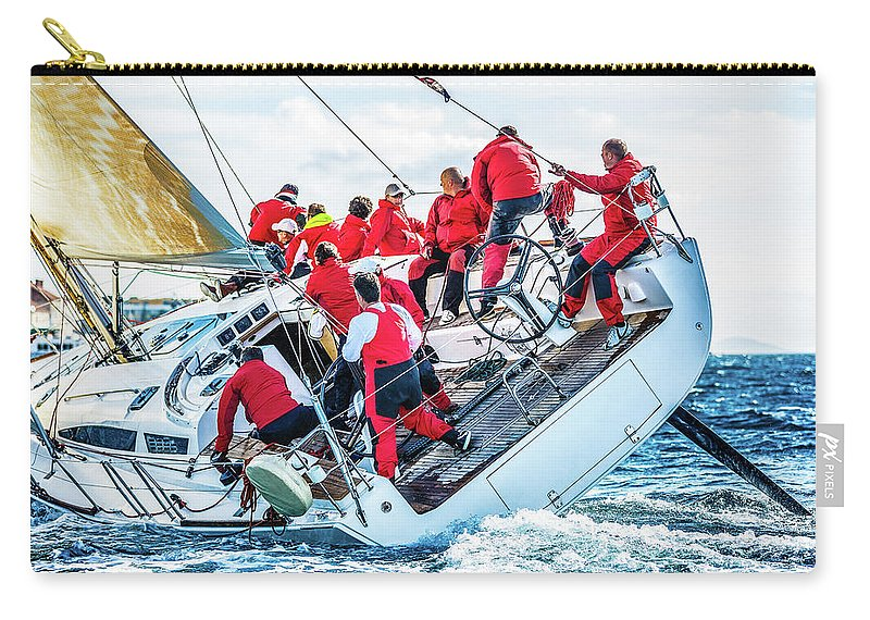 Adriatic Sea Carry-all Pouch featuring the photograph Sailing Crew On Sailboat During Regatta by Mbbirdy