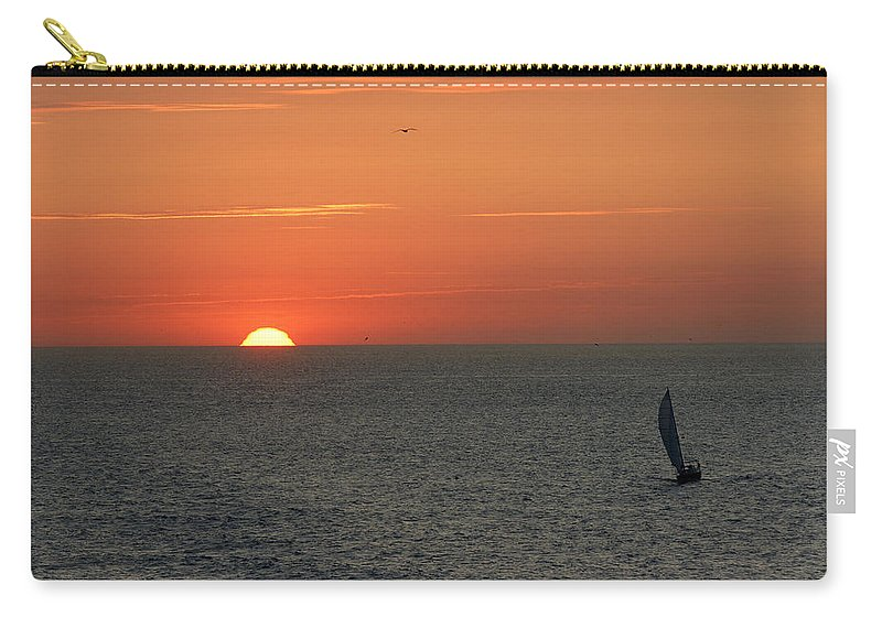 Boat Carry-all Pouch featuring the photograph Sailing From The Sun by Erik Tanghe
