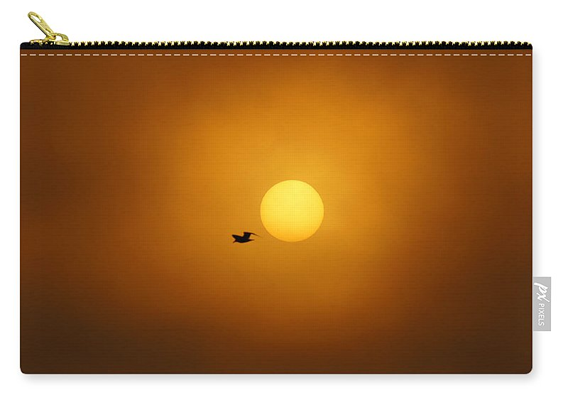 Sunrise Carry-all Pouch featuring the photograph Sailing Past The Sun by Bill Pevlor