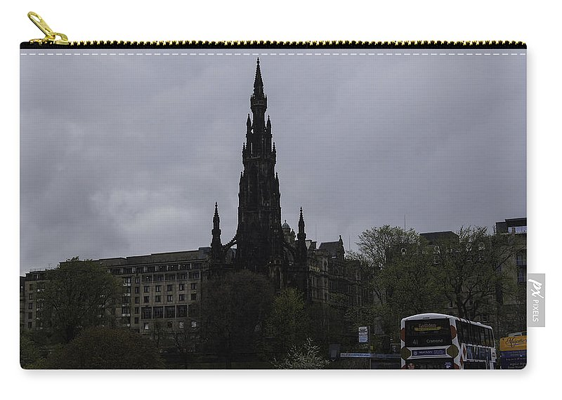 Action Carry-all Pouch featuring the photograph Scott Monument Next To Waverley Train Station And With Sightseeing Buses by Ashish Agarwal