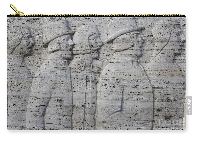 Travel Carry-all Pouch featuring the photograph Sculpture On The Side Of Riga's Freedom Monument by Jason O Watson