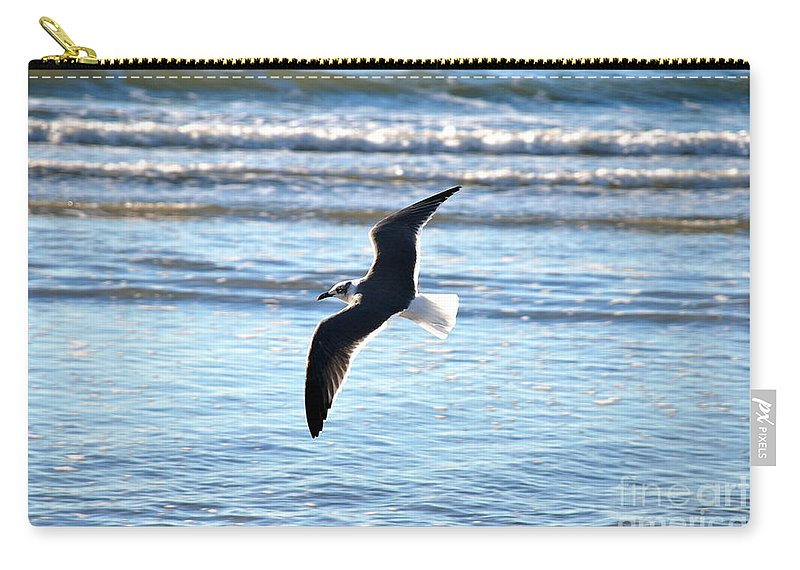Seagull Carry-all Pouch featuring the photograph Seagull Flight by M E Wood