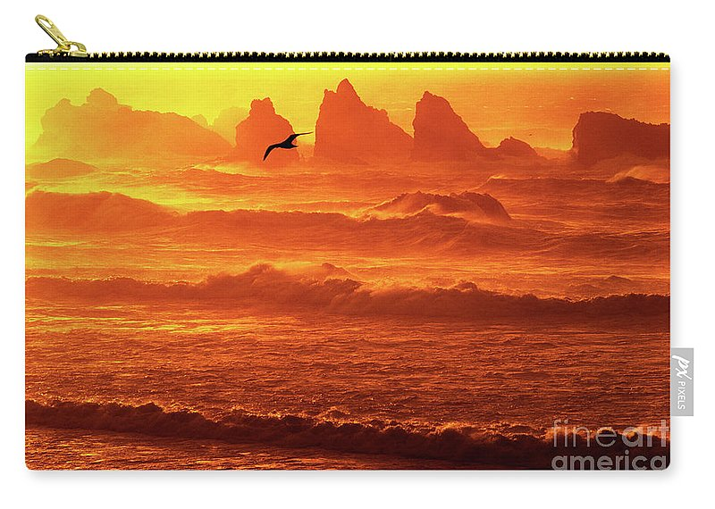 Oregon Carry-all Pouch featuring the photograph Seagull Soaring Over The Surf At Sunset Oregon Coast by Dave Welling