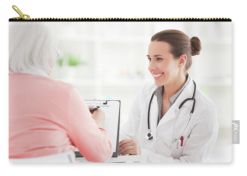 Mature Adult Carry-all Pouch featuring the photograph Senior Woman With Doctor by Svetikd