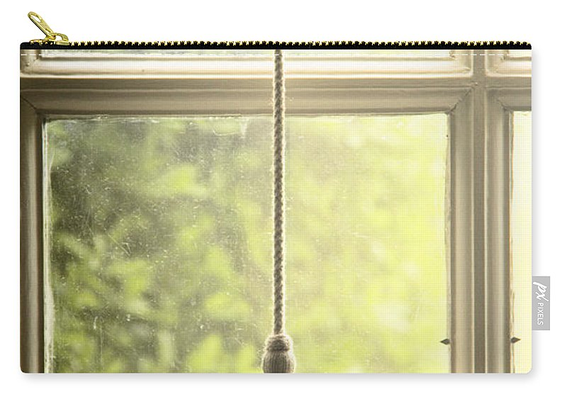 Window; Tassel; Blind; Drape; Curtain; Close; Closed; Fringe; Fabric; Glass; Pane; House; Home; View; See Through; Country; Detail; Trees; Green; Looking Out; Indoors; Inside; Close Up; Shade; Blind Carry-all Pouch featuring the photograph Shaded by Margie Hurwich