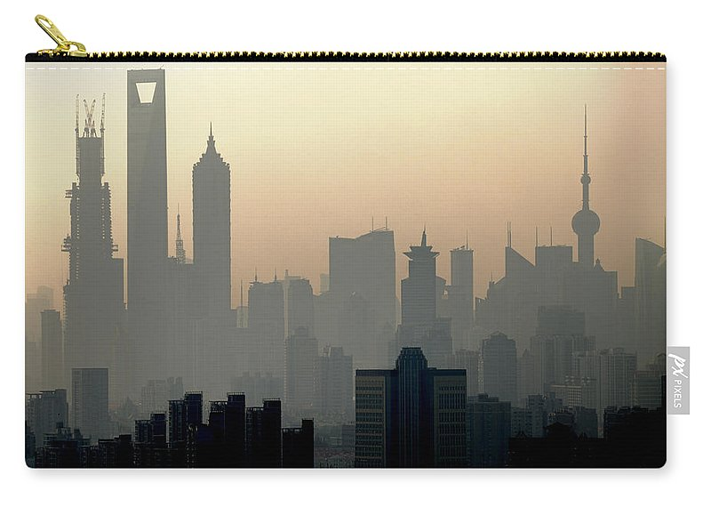 Dawn Carry-all Pouch featuring the photograph Shanghai Skyline Three Towers And Perl by Douglas Von Roy
