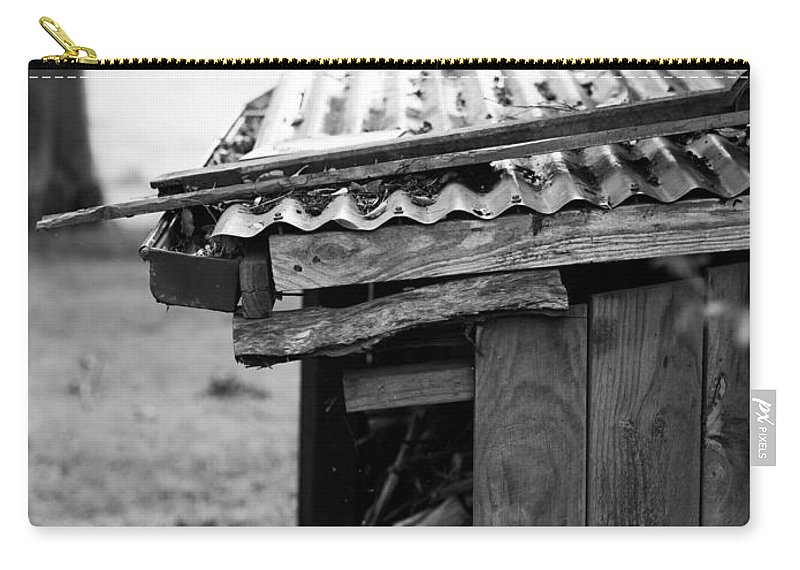 Black And White Carry-all Pouch featuring the photograph Sheltered Stockpile Long Forgotten by Kaleidoscopik Photography