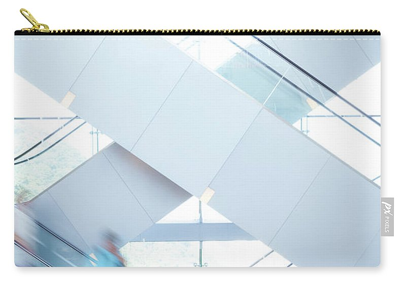 Buy Carry-all Pouch featuring the photograph Shopers In Motion by Uschools