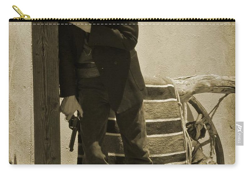 Gunslingers Carry-all Pouch featuring the photograph Shot In The Arm by John Malone