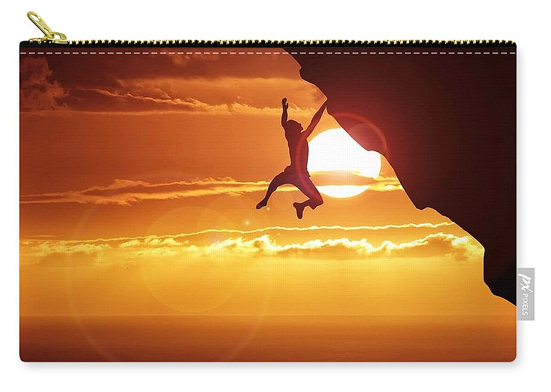 Tranquility Carry-all Pouch featuring the photograph Silhouette Man Hanging On Cliff Against by Stijn Dijkstra / Eyeem