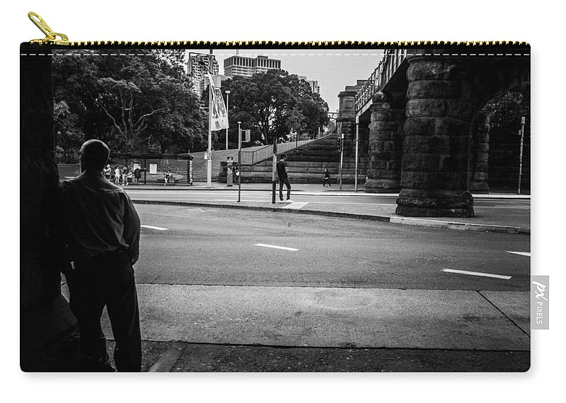 Male Carry-all Pouch featuring the photograph Silhouetted Man Leans Black And White by Kaleidoscopik Photography