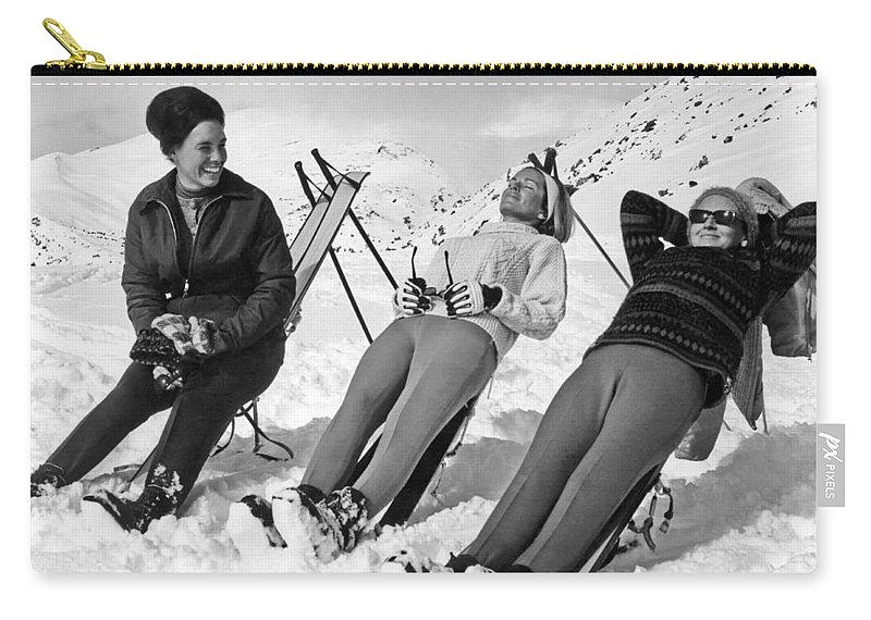 1956 Carry-all Pouch featuring the photograph Skiers Basking In The Sun by Underwood Archives