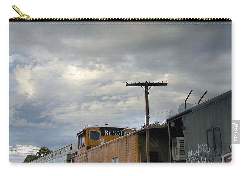 Sky Carry-all Pouch featuring the photograph Sky Clouds And Graffiti Old Santa Fe Railyard by Kathleen Grace