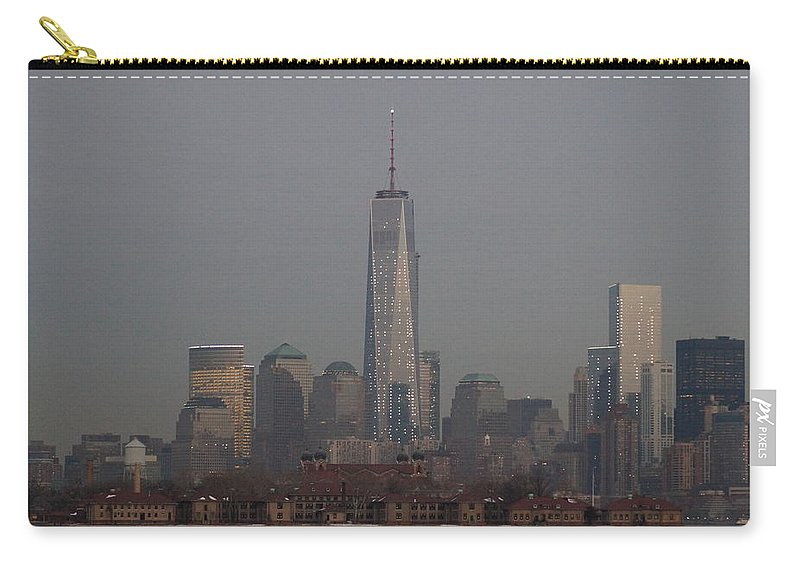 Freedom Carry-all Pouch featuring the photograph Skyline And Ellis Island At Dusk by John Wall