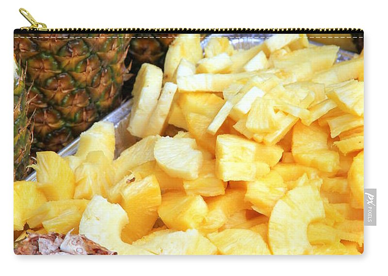 Slices Carry-all Pouch featuring the photograph Sliced Pineapple by Valentino Visentini