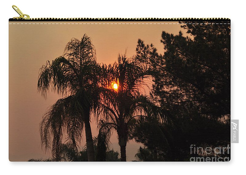 Sky Carry-all Pouch featuring the photograph Smoke Covered Sky Sunset Thru The Palm Trees by Jay Milo