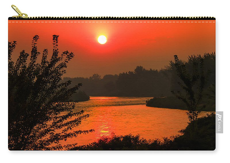 Sunrise Carry-all Pouch featuring the photograph Smokey Sunrise by Robert Bales