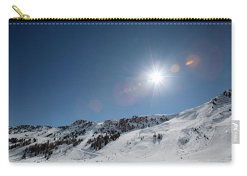 Scenics Carry-all Pouch featuring the photograph Snowy Ski Resort by Chris Tobin