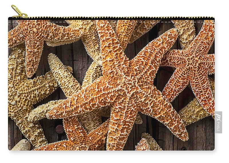 Starfish Carry-all Pouch featuring the photograph So Many Starfish by Garry Gay