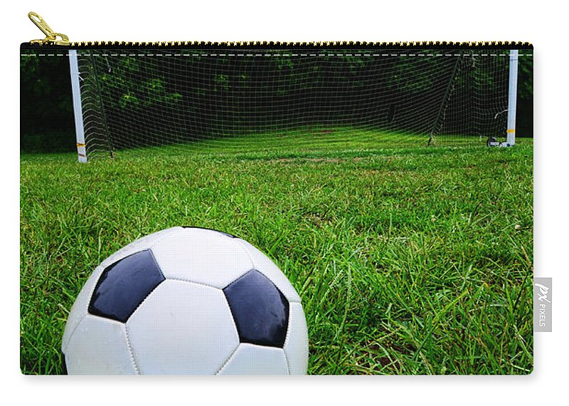 Paul Ward Carry-all Pouch featuring the photograph Soccer Ball On Field by Paul Ward