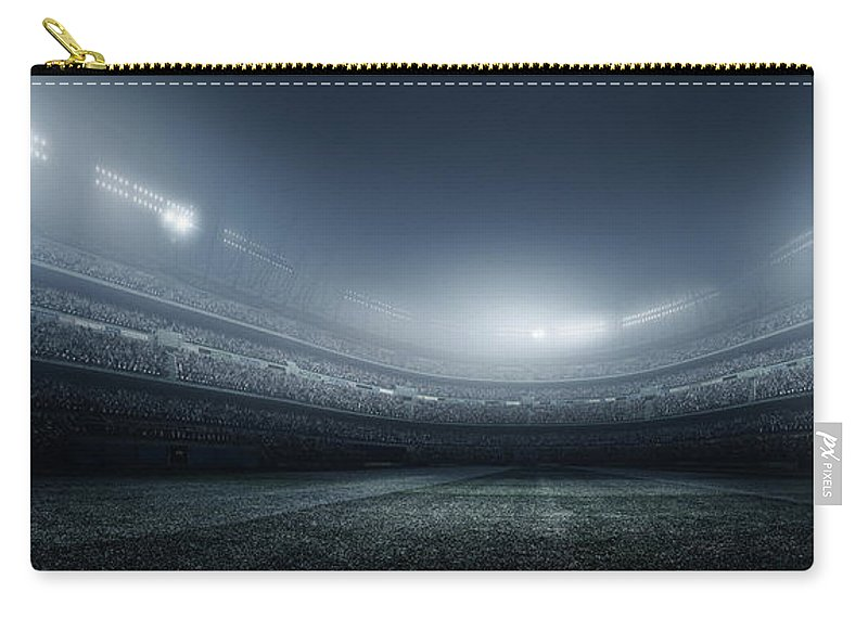 Soccer Uniform Carry-all Pouch featuring the photograph Soccer Player With Ball In Stadium by Dmytro Aksonov