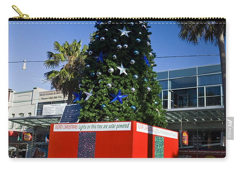Travel Carry-all Pouch featuring the photograph Solar Powered Christmas Tree by Jason O Watson