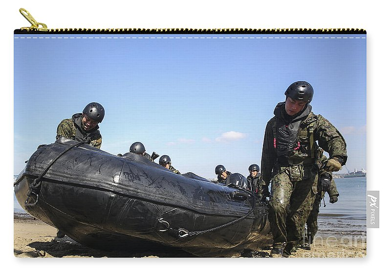 Japanese Carry-all Pouch featuring the photograph Soldiers Of The Japan Ground by Stocktrek Images