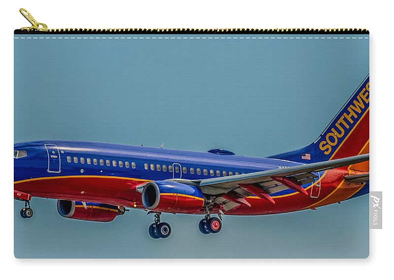 Plane Carry-all Pouch featuring the photograph Southwest 737 Landing by Paul Freidlund