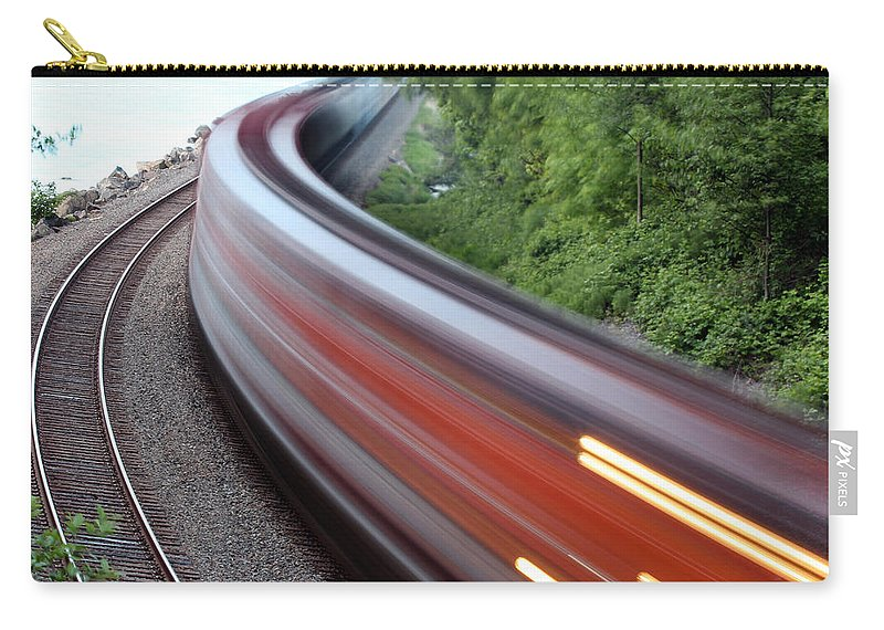 Blur Carry-all Pouch featuring the photograph Speeding Train by Paul Fell