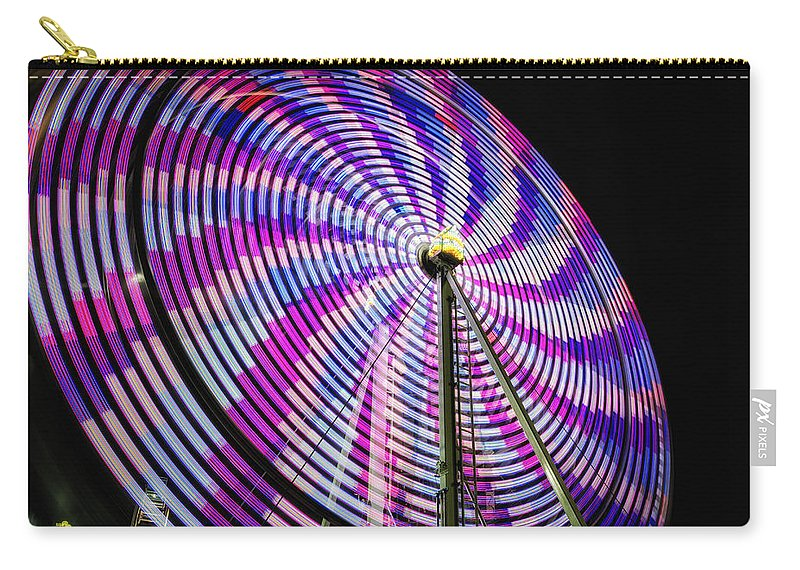 Action Carry-all Pouch featuring the photograph Spinning Disk by Joan Carroll