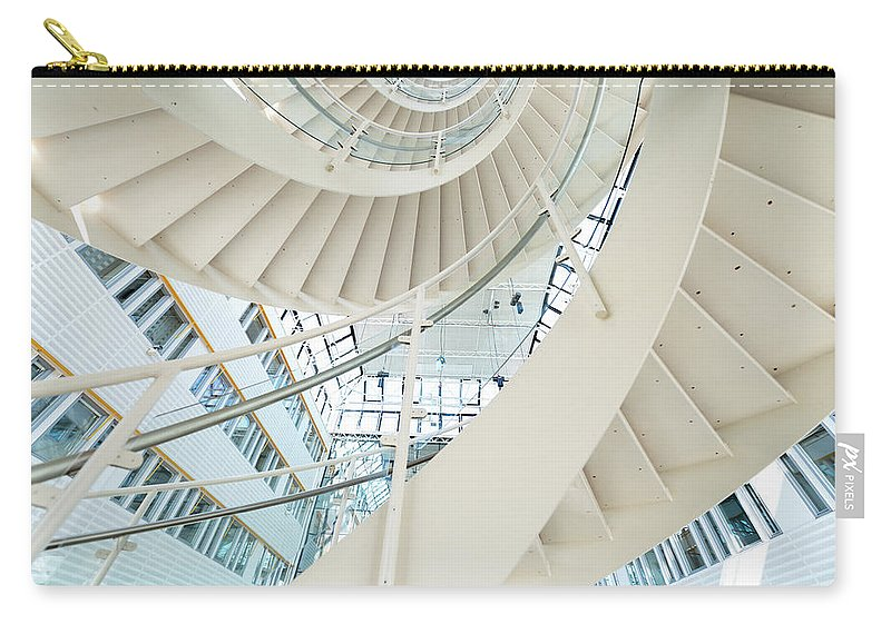 Steps Carry-all Pouch featuring the photograph Spiral Staircase Inside Office Complex by Blurra