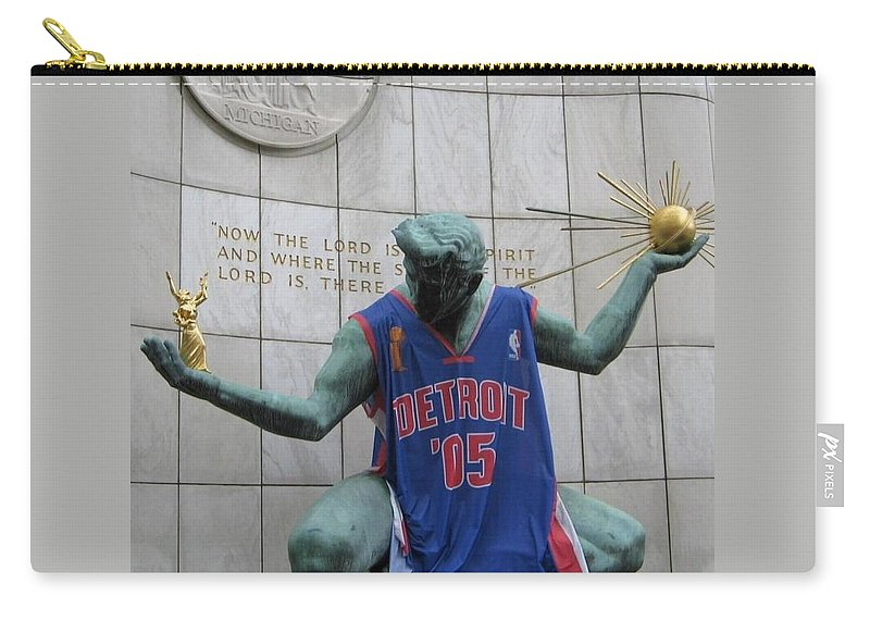 Spirit Of Detroit Carry-all Pouch featuring the photograph Spirit Of Detroit Piston by Crystal Hubbard