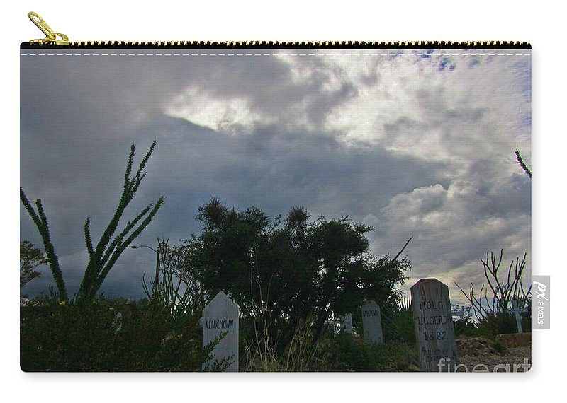 Spooky Boot Hill Cemetery Carry-all Pouch featuring the photograph Spooky Boot Hill Cemetery by John Malone