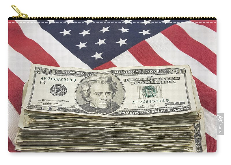 Flag Carry-all Pouch featuring the photograph Stack Of Money On American Flag by Keith Webber Jr