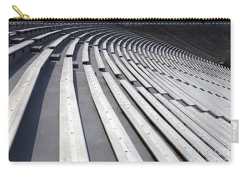 Scott Stadium Carry-all Pouch featuring the photograph Stadium Bleachers by Jason O Watson