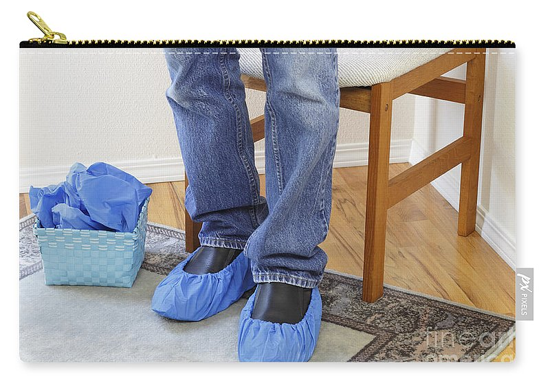 Booties Carry-all Pouch featuring the photograph Standing Person Wearing Booties by Lee Serenethos