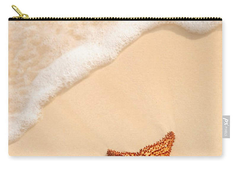 Starfish Carry-all Pouch featuring the photograph Starfish And Ocean Wave by Elena Elisseeva