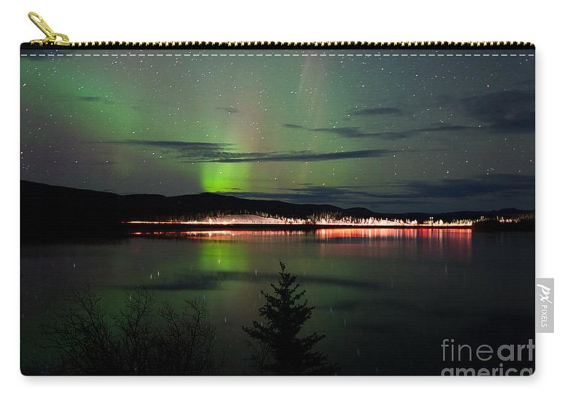 Above Carry-all Pouch featuring the photograph Stars And Northern Lights Over Dark Road At Lake by Stephan Pietzko