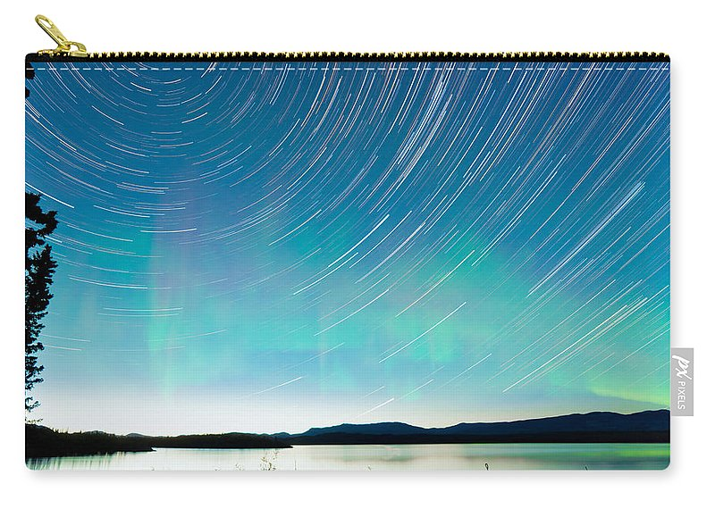 Astrophoto Carry-all Pouch featuring the photograph Startrails Aurora Borealis Display Lake Laberge by Stephan Pietzko