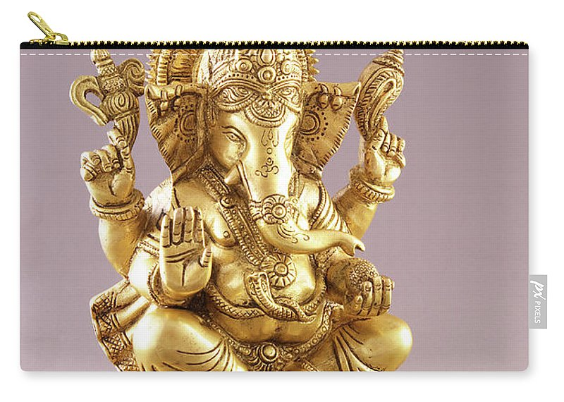 Spirituality Carry-all Pouch featuring the photograph Statue Of Lord Ganesh by Visage